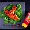 Warkocz z indyka na młodym szpinaku z sosem piri - piri